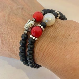 Set of two red and black beaded bracelets